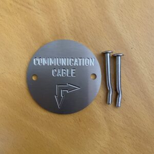 Stainless Steel Round Marking Plates & Labels - Communication Marker with 90deg Arrow – Communication Cable with Double Arrow – 75mm dia - Quality Australian Made Kerbmarkers, Tags & Plates since 1998 - CC75-3, Communication Cable w: 90deg arrow